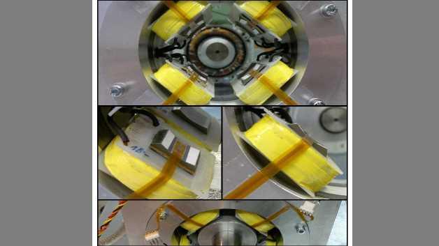 Magnetlager mit flussbasierter Regelung. Insgesamt acht flexible, ultradünne Hallsensoren sind auf den gekrümmten Statorpoloberflächen im Luftspalt (500 μm) montiert