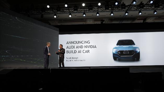 Huang begrüßte als Gast Scott Keogh, Audi-Präsident Amerika, und kündigte zusammen mit ihm an, bis 2020 fortschrittliche Autos mit eingebauter künstlicher Intelligenz auf die Straße bringen zu wollen