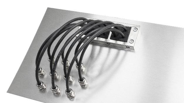 Auf Basis seiner Kabeleinführungsleisten bietet icotek Rahmen mit EMV-Abschirmung an. Die Rahmen zur Kabeleinführung sind hochleitfähig metallisiert und werkseitig vollflächig kratzfest lackiert. Die zugehörigen Kabeltüllen EMV-KT bietet icotek aus leitfähigem Elastomer. Schirm- und feldgebundene Störungen werden direkt über die Tülle und den Rahmen abgeleitet. Zwischen der EMV-KEL und der Metallwand wird zudem eine leitfähige Flachdichtung montiert. Diese ist im Lieferumfang enthalten. Abhängig vom Einsatzbereich lässt sich eine Schutzart von IP66 erreichen. Die EMV-Kabeleinführungsleiste bietet sich als Alternative zur herkömmlichen EMV-Kabelverschraubung an, weil laut Unternehmensangabe bedingt durch die hohe Packungsdichte im Vergleich zur EMV-Kabelverschraubung Platz gespart werden kann. Es ist nur ein Ausbruch in der Gehäusewand erforderlich. Das Produkt lässt sich mit anderen icotek-Produkten kombinieren und ist in verschiedenen Größen erhältlich.