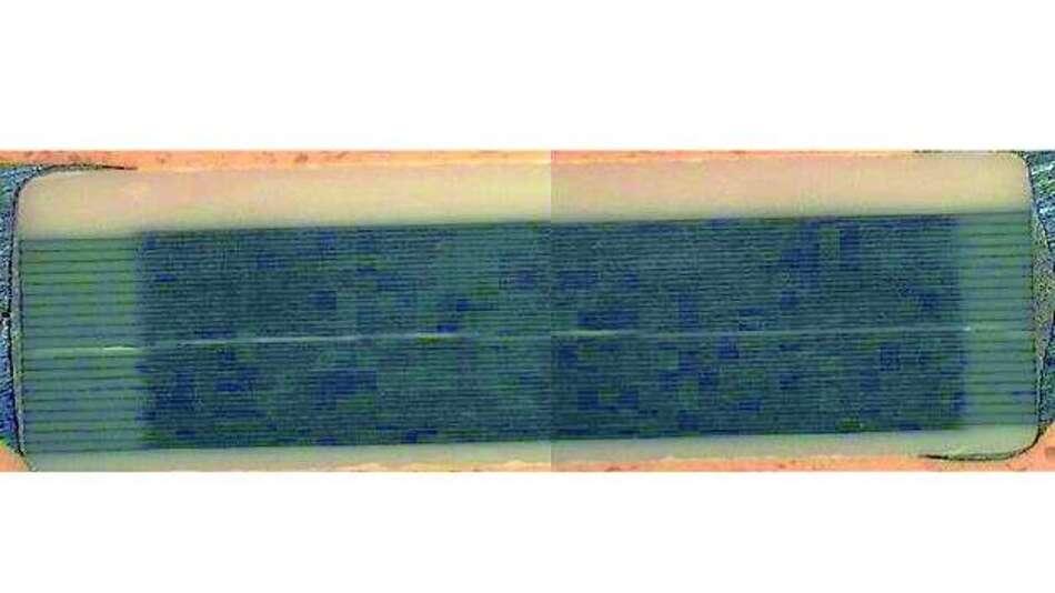 Bild 4: Querschnitt durch einen Vielschichtkondensator, der wegen eines von Piezoeffekten verursachten Risses ausgefallen ist