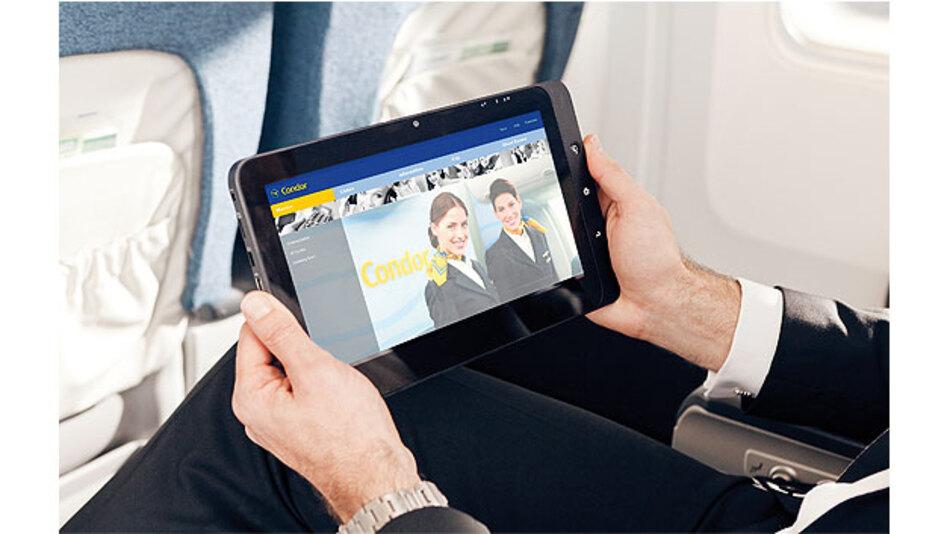 """Bild 1. Lufthansa Systems hat ein Flugzeug-WLAN namens """"BoardConnect"""" entwickelt, über das die Passagiere das Unterhaltungsprogramm mit ihren eigenen Geräten empfangen können."""
