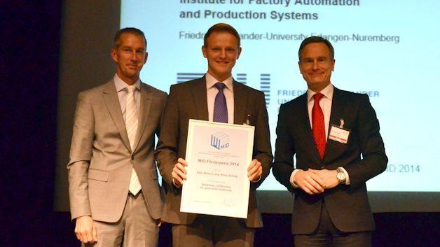 Die Forschungsvereinigung 3-D MID e.V. verleiht den MID-Förderpreis 2014 an Dipl.-Wirtsch.-Ing. Klaus Schütz.