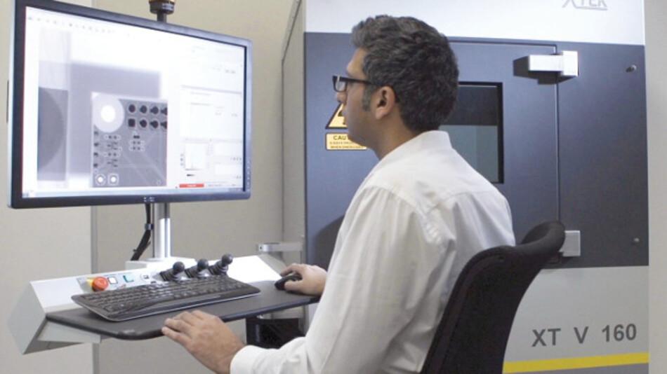 Kamran Iqbal, Nikon, with high-precision X-ray test system XT V 160