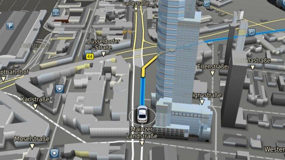 Bei der neuen Navigationssoftware bleibt auch eine hinter Häusern verlaufende Routenführung sichtbar.