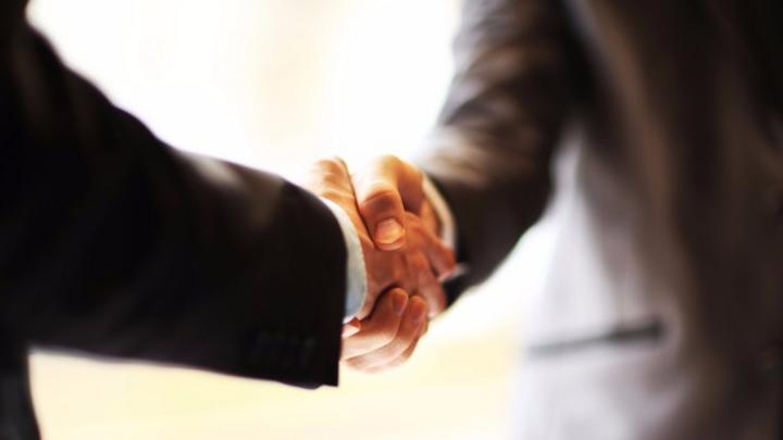 Schmuckbild Handshake Übernahme Einigung