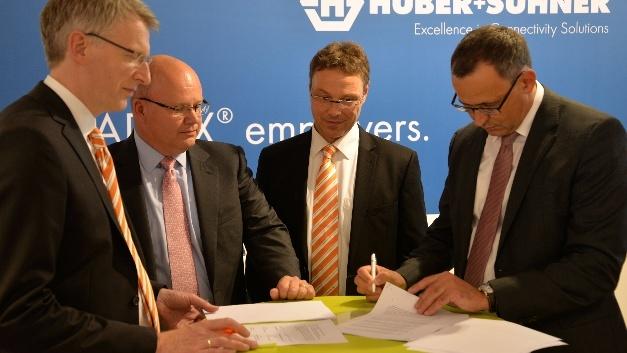 Weidmüller und Huber+Suhner intensivieren ihre Zusammenarbeit