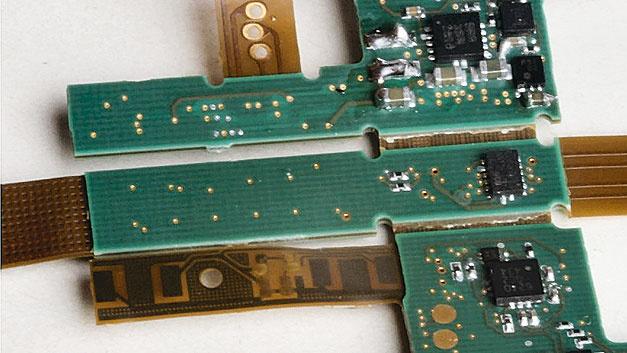 Bild 1. Bei einem Elektronikmodul für Mess-Applikationen mussten auf einer geringen Leiterplattenflächen zahlreiche Funktionen untergebracht werden; u.a. Lade-Elektronik, Calor-Zähler, Sicherheitsschalter, Bluetooth sowie mehrere Prozessoren und Motortreiber.