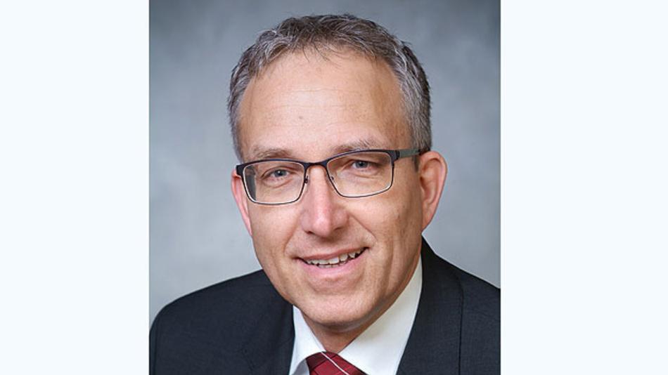 """Dr. Ulf Lange, Leiter des Referats Kommunikationssysteme, IT-Sicherheit am BMBF: """"Netzwerke sind das zentrale Nervensystem der Digitalisierung""""."""