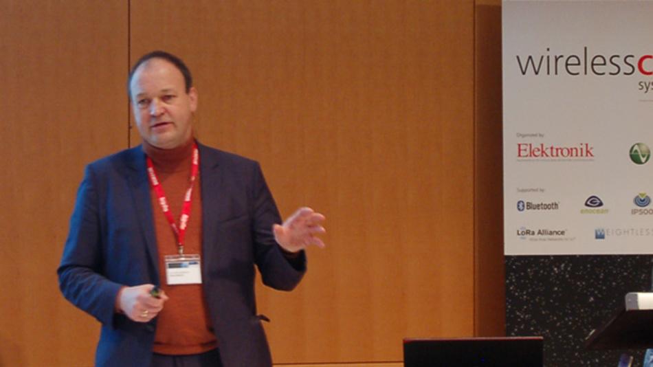 Bild 4. Dr. Ulrich Dropmann, Leiter der Normungsabteilung bei Bell Labs CTO, stellte in seiner Keynote die auf IoT-Anwendungen bezogenen Aktivitäten bei der Entwicklung jüngster und kommender Mobilfunkstandards vor – so auch die Portierung von LTE auf lizenzfreie Frequenzbänder.