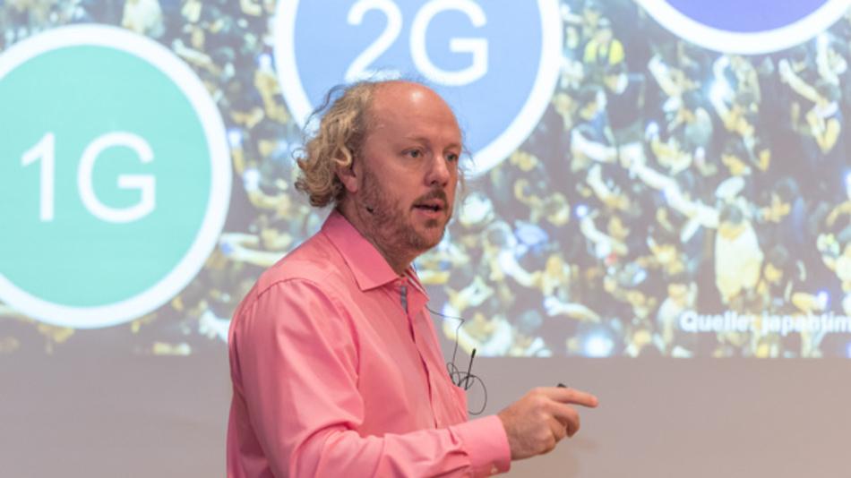 Bild 3. Prof. Dr.-Ing. Frank H. P. Fitzek, Deutsche Telekom-Professur für Kommunikationsnetze am Institut für Nachrichtentechnik der TU Dresden, stellte in seiner Keynote Applikationen vor, die sehr kurze Latenzen erfordern, die mit 5G realisiert werden sollen.