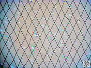 Ungleichförmiges Elektrodengitter um Moire-Effekte mit gleichmäßiger Pixel-Struktur zu verhindern sowie erkennbare optische Artefakte