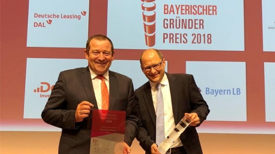 Prof. Bernd Hindel und Dr. Martin Geier freuen sich über den Bayerischen Gründerpreis 2018.