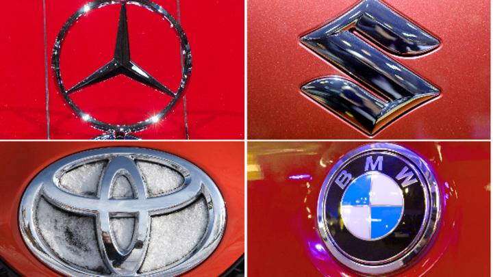 Logos von Mercedes, Suzuki, Toyota und BMW