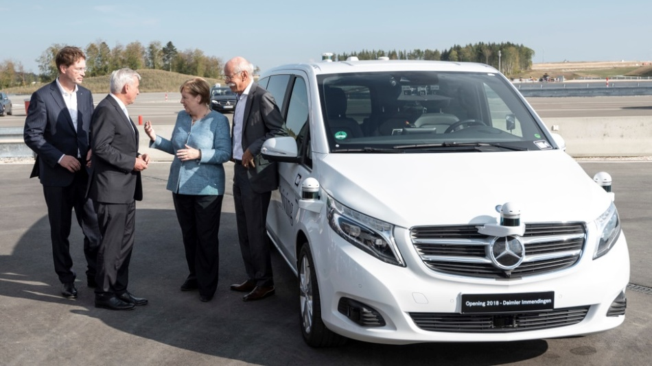 Ola Källenius, Member of the Board of Management of Daimler, Group Research & Mercedes-Benz Cars Development, Thomas Strobl, Deputy Prime Minister Baden-Wuerttemberg, Federal Chancellor Angela Merkel and Dieter Zetsche, Chairman of the Board of Management of Daimler at the Opening of the Daimler Test and Technology Center in Immendingen in front of a test vehicle Mercedes-Benz V-Class.