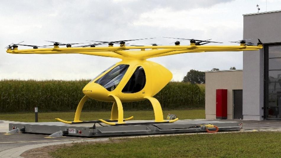 Die zweisitzigen Volocopter mit 18 kleinen, elektrisch betriebenen Rotoren sollen den Arzt schneller als im Notarzt-Einsatzfahrzeug zu Patienten bringen.