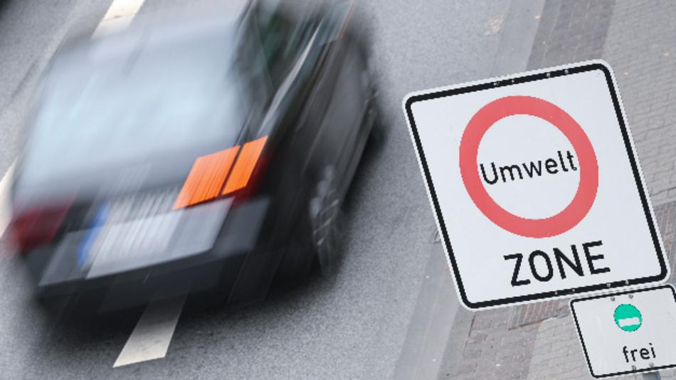 Ein Auto fährt auf der Theodor-Heuss-Allee nahe des Frankfurter Messegeländes an einem Verkehrsschild mit der Aufschrift »Umwelt Zone« vorbei.