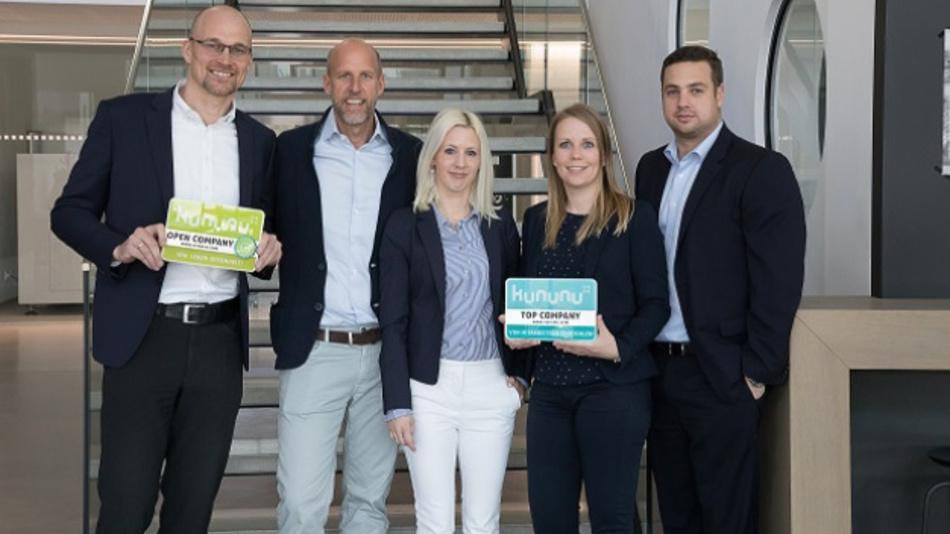 Sind stolz auf die Kununu-Auszeichnung:  Mag. Dr. Bianca Mastnak, Head of Human Resources Austria (Mitte, neben ihr CEO Karsten Bier).