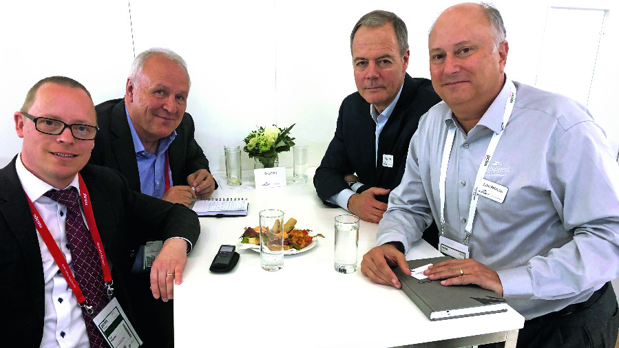 Our editor Ralf Higgelke together with Engelbert Hopf, Chief Reporter of Markt&Technik, Gregg Lowe, CEO of Cree/Wolfspeed, and John Palmour, Cree's co-founder and CTO of Wolfspeed (from left to right)