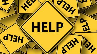 Schilder mit dem Schriftzug »Help« (Symbolbild)