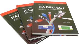 """172 Seiten im Hardcover: """"Praxishandbuch Kabeltest"""" von Meilhaus Electronic."""