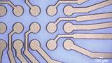Eine Anwendung des ProtoLaser-Systems ist wie hier die Strukturierung einer Kupferschicht auf PET-Folie.