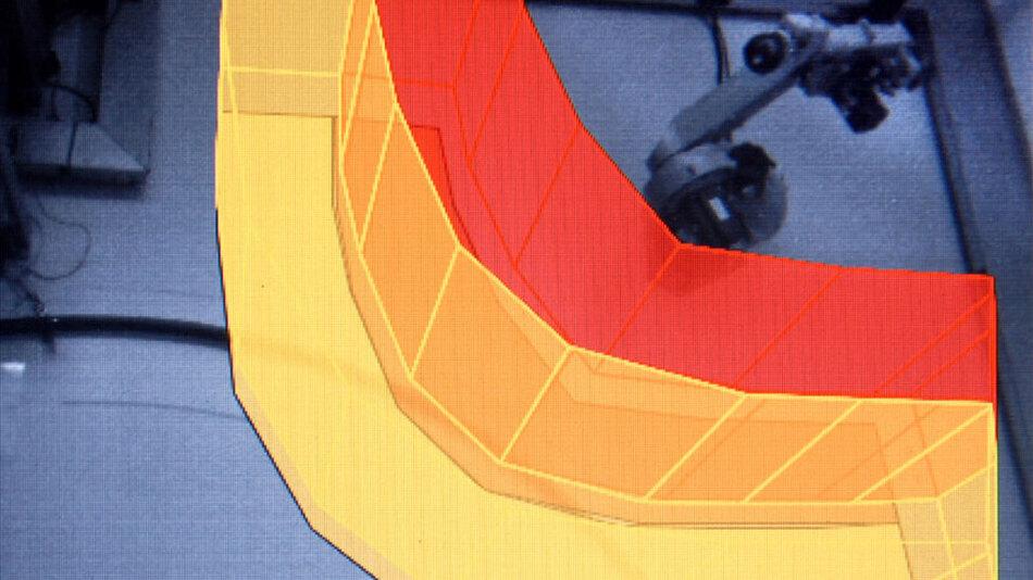 Bild 2. SafetyEye am Beispiel einer Roboter- Zelle: Das System erkennt sofort, wenn eine Person in den gelb markierten Warnraum eindringt, und sorgt dafür, dass sich der Roboter extrem verlangsamt weiterbewegt. Betritt die Person den roten Schutzraum, wird ein Not-Stopp veranlasst.